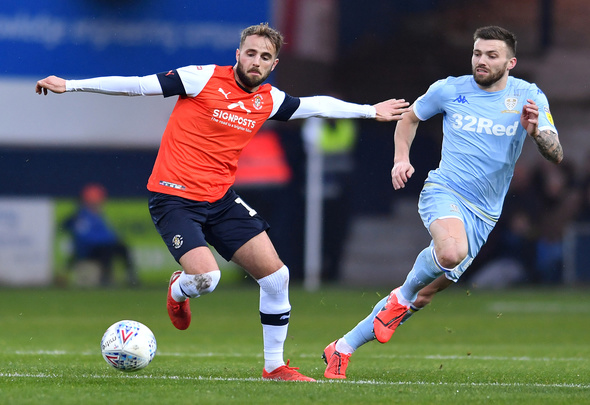 """Soccer Football - Championship - Luton Town v Leeds United - Kenilworth Road, Luton, Britain - November 23, 2019 Luton Town's Andrew Shinnie in action with Leeds United's Stuart Dallas Action Images/Alan Walter EDITORIAL USE ONLY. No use with unauthorized audio, video, data, fixture lists, club/league logos or """"live"""" services. Online in-match use limited to 75 images, no video emulation. No use in betting, games or single club/league/player publications. Please contact your account representative for further details."""