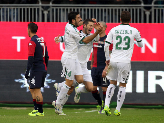 CAGLIARI, ITALY - DECEMBER 01: Marzoratti Lino of Sassuolo celebrates with team-mates after scoring a goal during the Serie A match between Cagliari Calcio and US Sassuolo Calcio at Stadio Sant'Elia on December 1, 2013 in Cagliari, Italy. (Photo by Enrico Locci/Getty Images)