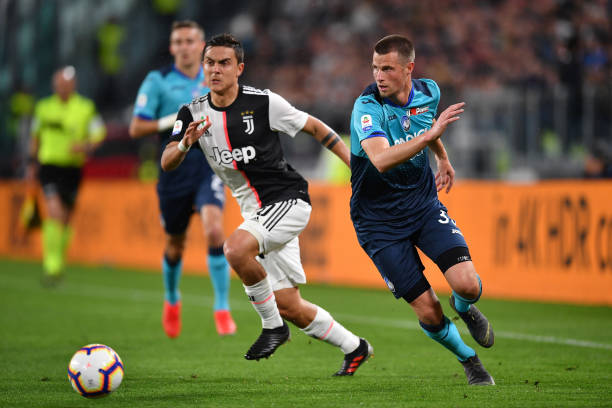 TURIN, ITALY - MAY 19: Paulo Dybala of Juventus competes for the ball with Hans Hateboer of Atalanta BC during the Serie A match between Juventus and Atalanta BC on May 19, 2019 in Turin, Italy. (Photo by Valerio Pennicino - Juventus FC/Juventus FC via Getty Images)