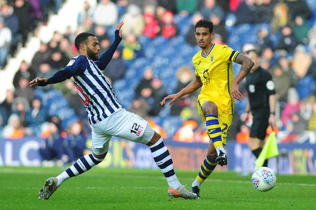 BIRMINGHAM, ENGLAND - DECEMBER 08: Kyle Naughton of Swansea City in action with Matheus Pereira of West Brom during the Sky Bet Championship match between West Bromwich Albion and Swansea City at The Hawthorns on December 08, 2019 in Cardiff, Wales. (Photo by Athena Pictures/Getty Images)